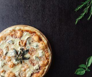 4 Formaggi Pizza with Mozzarella, Taleggio, Fontina and Gorgonzola. Because... cheese is life!